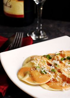Lobster Ravioli with Champagne Cream Sauce....I will probably never make this, but holy CRAP it sounds amazing