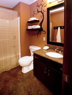 This is close to my wall color.  It looks like the furniture is dark brown, so maybe the floor is OK?