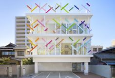 emmanuelle moureaux architecture + design have recently completed Creche Ropponmatsu, a new kindergarten located in a residential area in Fukuoka city, Japan. On the facade of the kindergarten ther. Kindergarten Architecture, Kindergarten Design, Kindergarten Lesson Plans, Design Exterior, Facade Design, Modern Exterior, Fukuoka, Building Exterior, Building Facade