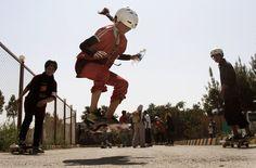 An Afghan girl jumps on her skateboard in Kabul, on June 21, 2012. Hundreds of Afghan boys and girls celebrated World Skateboarding Day in Kabul. (AP Photo/Ahmad Jamshid) #