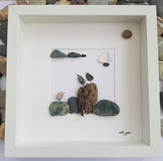 This is a beautiful and unique handmade pebble art picture of Three birds standing a lovely piece of driftwood and rocks with sea glass sail boat in distance. I can include printed quotes or personalised messages onto picture if required. Before sending you the picture I will email you images of the picture through the stages and to ensure that you are happy with the finished product,. This picture is a lovely home decoration and would make a perfect gift. The pictures is made using pebbles…