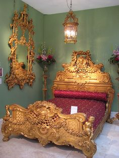 OMG!!! Gilt-wood English pier glass (c. 1770) together with a French Louis XIV gilt-wood bed (c. 1870)