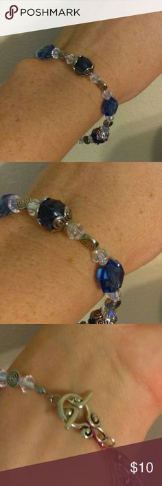 """Handmade Bracelet Royal Blue & Clear Crystals This handmade bracelet is made with royal blue crystals, clear crystals and silver accents. The bracelet approximately 7.5"""". This is the average bracelet size, please ask about adding an extender if necessary for no additional charge. Jewelry Bracelets"""