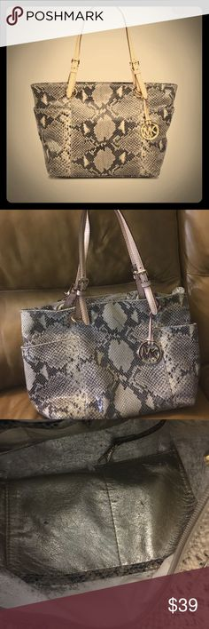 Authentic MK !! Was one of my favorite Pre loved but still in good condition the inside it's faded because it's leather , but the outside it's in good condition Bags Totes
