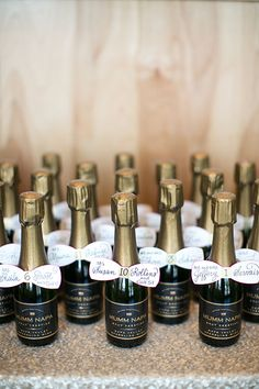 These adorable mini champagne bottles double as table numbers and wedding favors. Champagne Wedding Favors, Wedding Favours Bridesmaids, Mini Champagne Bottles, Mini Bottles, Creative Wedding Favors, Wedding Favors Cheap, Bottle Centerpieces, Wedding Centerpieces, Wedding Decorations