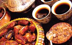 Arabic coffee alongside a plate of apricot stuffed medjool dates