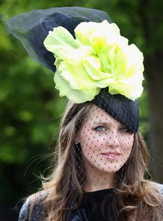 VERONICA VORONINA Model Veronica sports a little black beret-shaped  fascinator with a huge yellow flower - all that black tones the yellow down  a bit and ... c548cd324c00