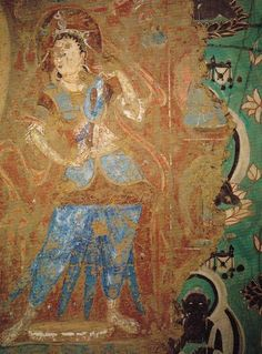 Early mural revealed after later over-painting had been partly removed. The flesh tones of the figure with its pigments protected from oxidation contrast with the darkened tone of buddhas in later painting seen on the right. Cave 253, Northern Wei.