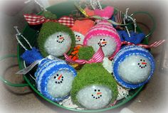 Snowman ornaments filled with snow and small hats made from baby sock with a tied ribbon...ADORABLE!