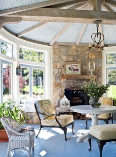 The fireplace on the sunporch is backed by an outdoor fireplace that shares the flue.