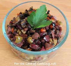 Three Olive Tapenade    1/2 cup of kalamata olives  1/2 cup of green olives with pimentos  1/4 cup of black olives  1 clove of garlic, minced  1 tbsp olive oil  1 tbsp balsamic vinegar