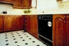 Properly prepared linoleum flooring can support new self-stick tiles.