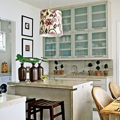 like the frosted glass (line with rice paper or vellum maybe) and the decorative shade. nice neutral counter and backsplash too