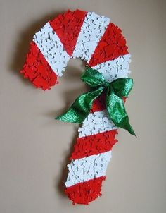 Candy cane Christmas decoration made from puzzle pieces
