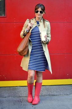 Caroline from House of Harper blog pairs red Wellies with a navy striped dress for a nautical feel on a rainy day