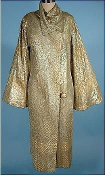 c. 1920's RARE Silver on Ecru Net Deco Assuit Coat! --   assuit cloth is a cotton mesh fabric embroidered with hammered metal pieces named for the Assuit region of Egypt. This cloth was most popular in the 1920's.