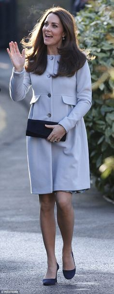 Kate Jan 19 2015 All smiles: The Duchess was on cheerful form as she arrived