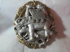 Vintage Safari Pin Pewter on Brass Collage Elephants Zebra Lion Giraffe Carved Elephants, Giraffe, Vintage Safari, Lucky Penny, Retro Costume, Brooch Pin, Pewter, Lion Sculpture, Collage