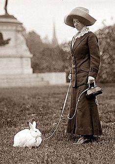 Edwardian woman walking rabbit on leash