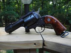 I have been on a single action kick lately and have been researching things you can do to customize a Ruger Blackhawk (I just finish. Sci Fi Weapons, Weapons Guns, Guns And Ammo, Custom Revolver, Custom Guns, Ruger Revolver, 9mm Pistol, Rifles, Single Action Revolvers