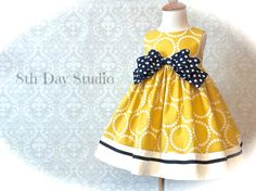 PLEASE READ!! >> Easter dress orders for 2017 MUST BE PLACED BY MARCH 26, 2017!!! If you are ordering multiple items, your order MUST be placed no later than MARCH 12!  For special occasions, church, weddings, or Easter, this girls or toddlers yellow and navy bow dress is new for Spring 2017 and available in sizes 18 mo. - 8. A sophisticated color palette for Easter or other special occasions, this deep yellow dress features navy accents and a creamy white border. The manufacturer calls...