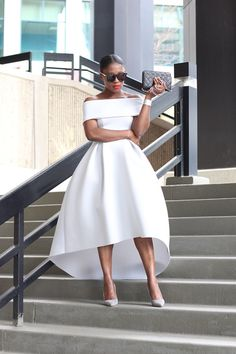 White off shoulder dress looks very Olivia Pope