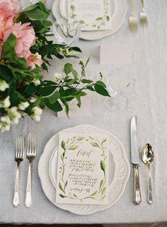 Calligraphed menu on a scalloped ceramic plate   Photo by Jose Villa #greenandwhite #placesetting #elegant