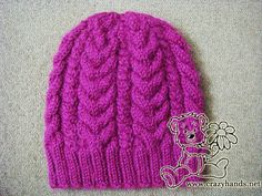 SIZE: Adult 52-54 cm Gauge: 16 stitches = 4 inches ABBREVIATIONS: k – knit p – purl k2tog – knit two together Cable 3 Back (C3B): Slip 3 knit stitches to the extra needle and hold in back of work, 3k from the left hand needle, 3k from the extra needle. Cable 3 Front (C3F): …