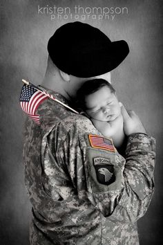 m.3 this photo says a lot , this really is an inspiring photo. I like that they did the background in black and white and i also like that they had the baby holding the flag.