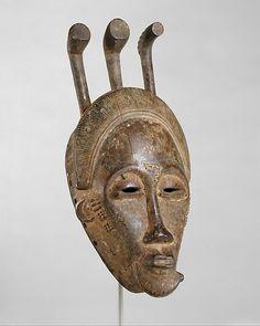 Portrait Mask (Mblo) Date: late 19th–early 20th century Geography: Côte d'Ivoire, central Côte d'Ivoire Culture: Baule peoples Medium: Wood, pigment