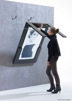 So cool - fold out table/picture frame. Perfect solution for small rooms:-)