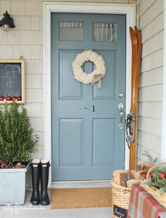 City Farmhouse Simple Front Door- Pom Pom Wreath & Vintage Ski's