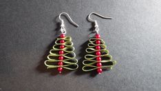Christmas tree earrings made with ribbon and red glass beads. Perfect for a unique, Holiday gift or stocking stuffer! Comes with a gift box!