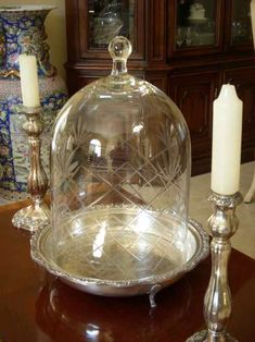 I adore glass domes and use them frequently and in a variety of ways.  This particular dome is etched crystal and is unusually tall. While it could be used to showcase a decadent dessert. An object like this would fetch a handsome price due to its size alone, never mind the fact that it is etched crystal.  I doubt that it is very old, but for just under $10, who could complain?  By the way, the footed silverplate tray and candlesticks were also sourced from thrift stores at unbeatable…