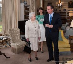 The Queen is welcomed to Chequers, the country residence of the Prime Minister, by David and Samantha Cameron, 28 February 2014.