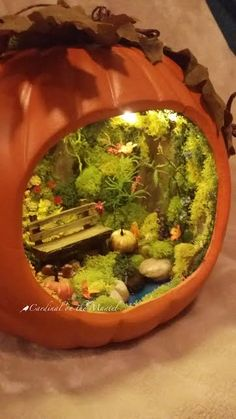 Fairy Garden in Pumpkin by Cardinal on the Mantel. Note lights and pond! - Fairy Garden in Pumpkin by Cardinal on the Mantel. Note lights and pond! Halloween Diorama, Halloween Fairy, Halloween Pumpkins, Halloween Halloween, Pumpkin Contest, Fairy Crafts, Ideias Diy, Miniature Fairy Gardens, Pumpkin Decorating