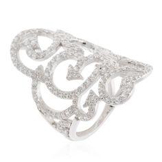 Diamonique, anello a fascia in argento 925 placcato rodio. La parte superiore, con design fantasia traforata, è composta da file ondulate di diamonique tondi con estremità a forma di freccia. La luce Diamonique fa sempre centro.