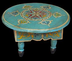 Hand painted Moroccan table. {imported}    design notes: could DIY build & paint. There's an antique glaze going on there.