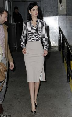 Krysten Ritter- Stunning! The actress, who's best known for playing June Colburn in the hit series Don't Trust the B---- in Apartment 23, wore a sophisticated black and white striped blouse and a beige skirt with a sexy thigh high slit