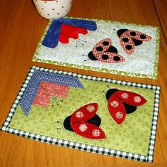 Ladybugs - or ladybirds as we call them in England.  This mug rug pattern comes with the option to patch or applique the flower.  You also have to decide whether your ladybirds will include gingham wings (as shown at the top) or scrappy dots (as shown at the bottom).  Decisions, decisions, decision.  Don't worry though - the pattern is super-quick and you will have plenty of time for both!