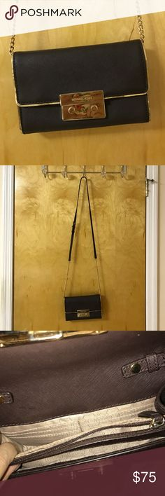 Michael Kors Crossbody Bag Dark Brown Michael Kors Crossbody bag with adjustable strap! Scratches on the front but overall cute bag to wear! Color is super dark, could pass as black! Michael Kors Bags Crossbody Bags