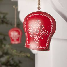 Christmas cow bell decorationWe have long been keen fans of red & white schemes at Christmas and these Nordic style bell decorations whilst designed to be a Christmas tree decoration also look wonderful hung in the centre of Christmas Wreaths, on door handles or fireplaces. A lovely quality decoration that will last for years to come. Painted in a rich red with lovely white patterns we think a must have addition to any Christmas Decoration collection.MetalHeight: 9cm Width: 8cm