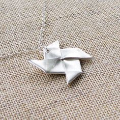 Origami Windmill Necklace - $60.00: ORIGAMI BIJOU - Handmade Origami Jewelry, by Cindy Ng Definitely need to get one of these - gorgeous.