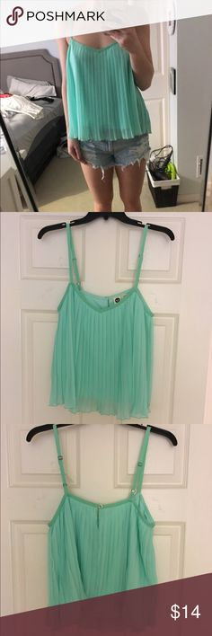ROXY Swing Top ROXY Swing/Babydoll Style Top ▪️ Pleated Crepe Fabric ▪️ Beautiful Spring Teal/Aqua Color ▪️ Button detail back closure ▪️ Size Medium ▪️ Could fit a small or medium body type ▪️Looks great with shorts or pants ▪️Only worn twice/In like-new condition Roxy Tops Tank Tops