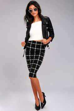 Style possibilities abound in the Strike a Pose Black and White Grid Print Pencil Skirt! Lightweight stretch knit, in a black and white grid print, shapes a high, elasticized waist, and figure-flaunting pencil silhouette with a midi length.