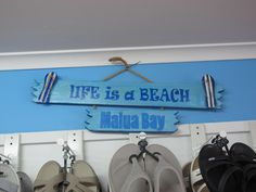"If you have a holiday house you need one of these 😉 These locally made signs can be made to order. This one says ""Life is a Beach, Malua Bay"""