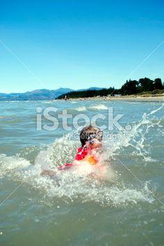 Child Splashing in Sea Royalty Free Stock Photo
