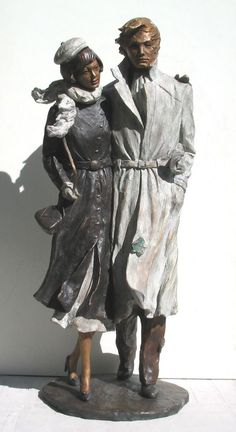 Bronze Sculptures of females by artist Vittorio Tessaro titled: 'Autumn in the City (Small Young Couple Windy Day statuettes statues)'