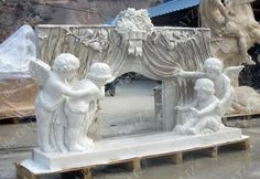 This mantel was all hand carved from a single block of marble. Measures: wide x tall x deep Whimsical Marble Fireplace Mantel with Carved Children Angels Opening a Theater Curtain - thegatz Tv Over Fireplace, Marble Fireplace Mantel, Country Fireplace, Fireplace Seating, Fireplace Garden, Paint Fireplace, Shiplap Fireplace, Concrete Fireplace, Marble Fireplaces