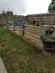 Mike's garden fence I designed, built by nicknme, stain, level, gate, and chicken wire left to go. Made of lowes cinder block and timbers